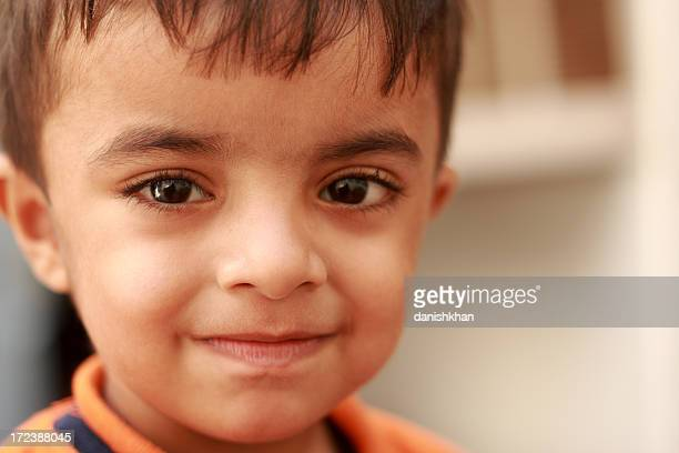 beautiful smile - cute pakistani boys stock photos and pictures