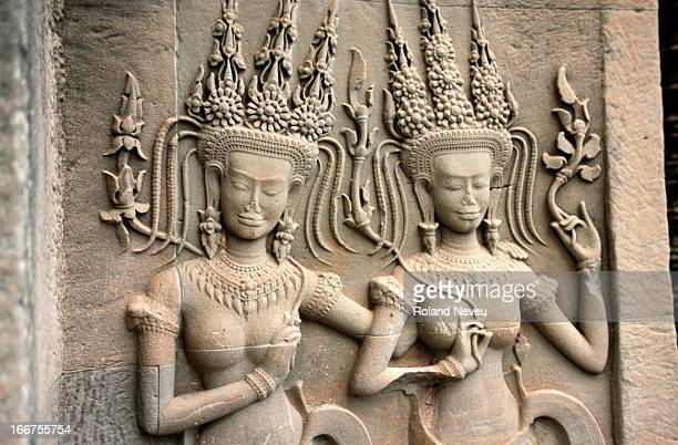 Beautiful smiling barechest apsara at the terrace of the Angkor Wat temple in Siem Reap