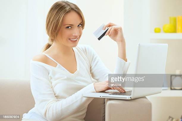 Beautiful smiling blond woman, shopping online from home