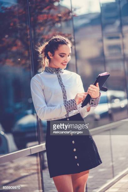 beautiful smiling female student using digital tablet in the city - little girls up skirt stock pictures, royalty-free photos & images