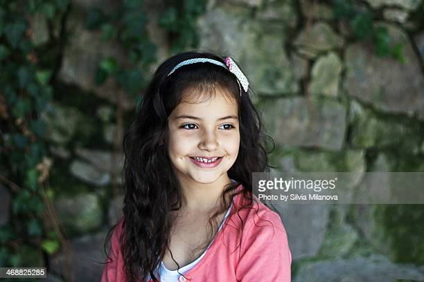 Beautiful smiling  little girl with dark hair