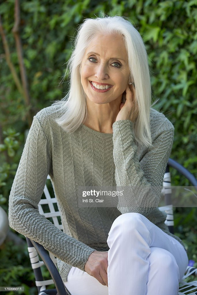 Beautiful Smiling Mature Woman Outside Stock Photo  Getty Images-4877