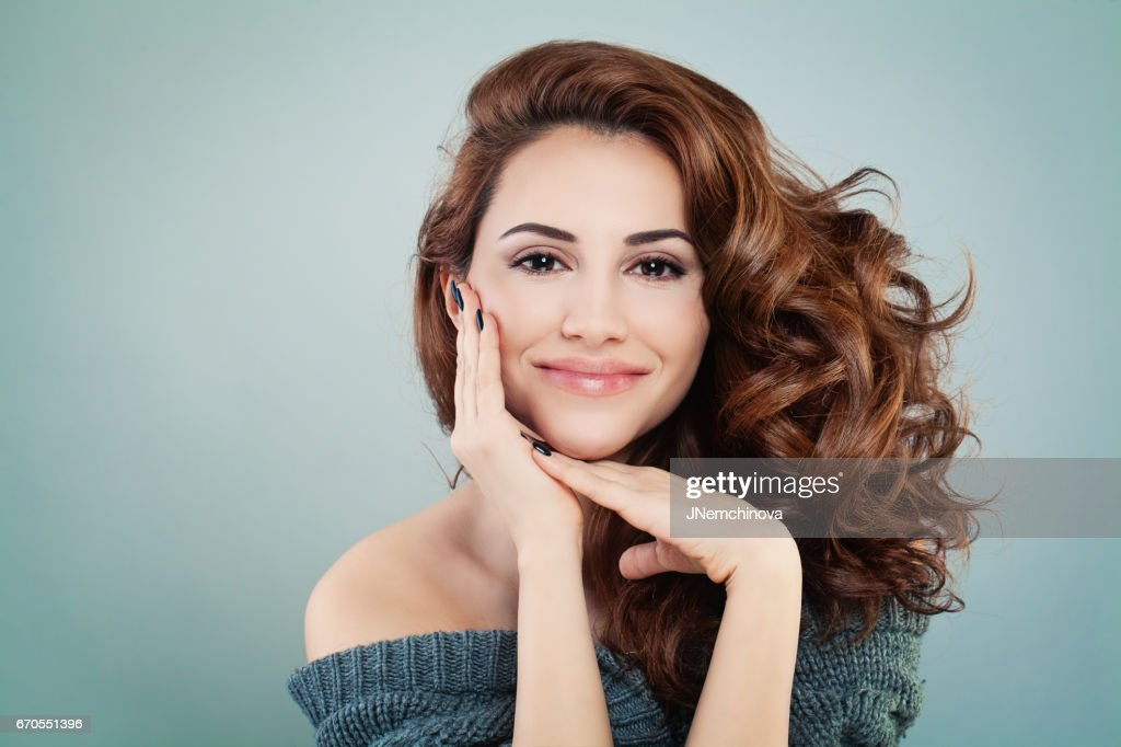 Beautiful Smiling Model Woman with Wavy Hairstyle. Cosmetology and Treatment Concept : Stock Photo