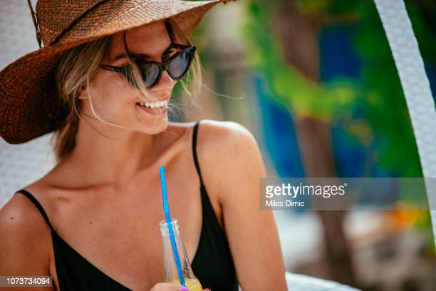 beautiful smiling woman drinking juice at the pool - hot female models stock pictures, royalty-free photos & images
