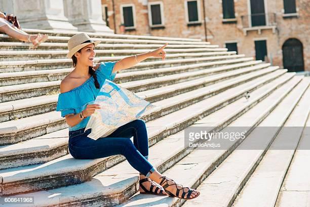 beautiful smiling woman exploring the city