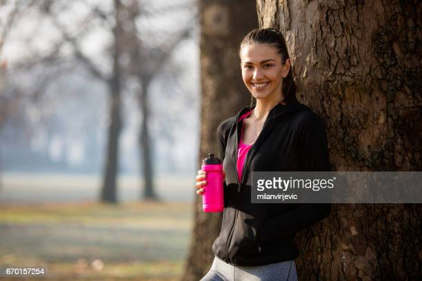 Beautiful smiling woman in park after workout