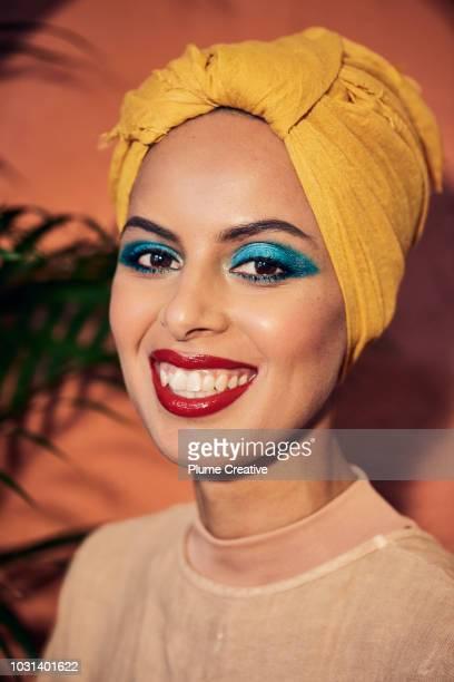 Beautiful smiling woman in yellow hijab