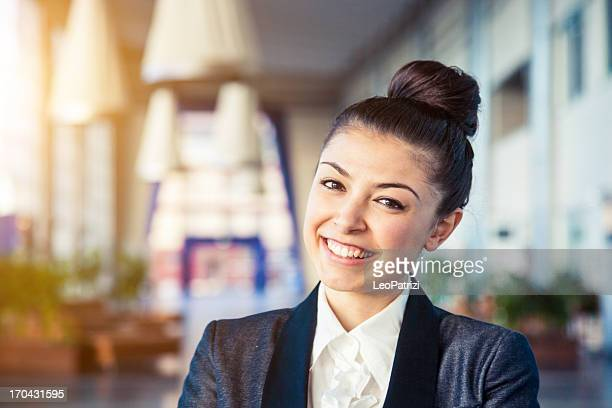 Beautiful smiling woman posing in a luxury restaurant