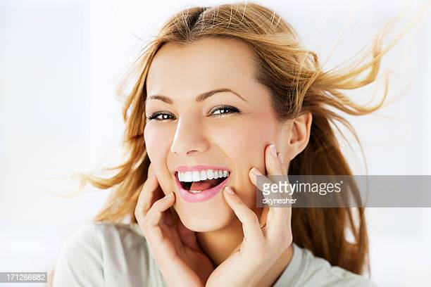 Beautiful smiling woman with long blowing hair.
