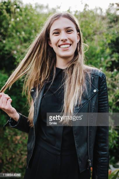 beautiful smiling young woman looking at camera - straight hair stock pictures, royalty-free photos & images