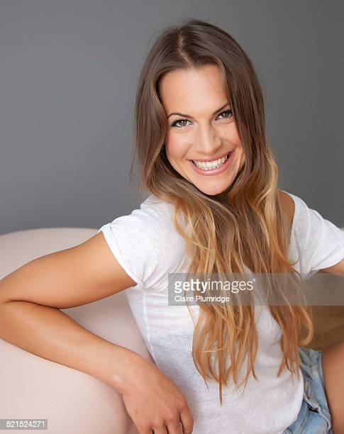 beautiful smiling young woman - claire plumridge stock pictures, royalty-free photos & images