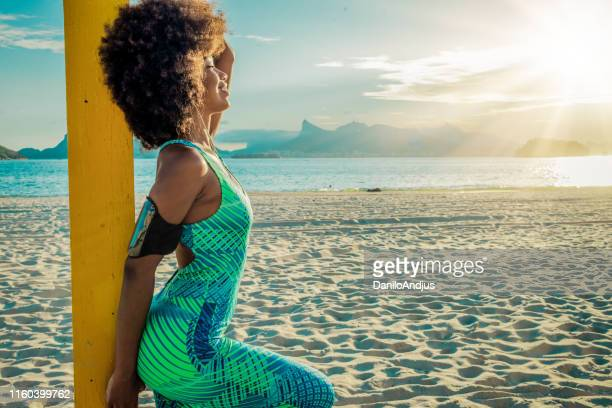 beautiful smiling young woman taking a break from training - sexy young women stock pictures, royalty-free photos & images