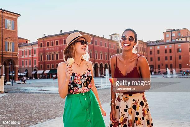 beautiful smiling young women having fun on the town square