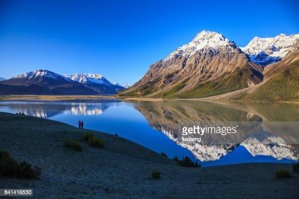 beautiful snow capped mountains and lakes - reflection lake stock photos and pictures
