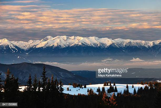 Beautiful snowcapped mountan sunrise with clouds