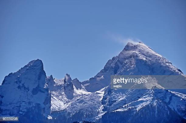 Beautiful snowcapped twin peak mountain against clear blue sky