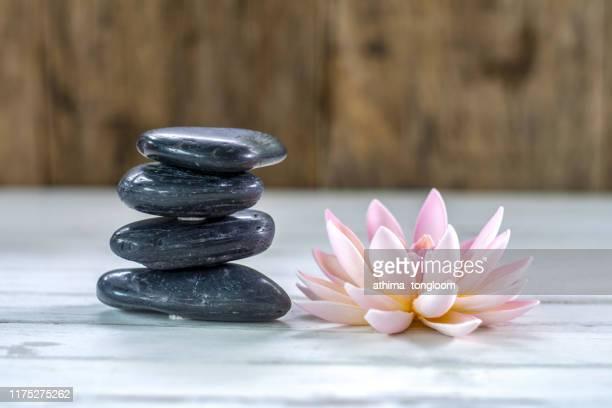 beautiful spa composition on massage table in wellness center - thai massage stockfoto's en -beelden