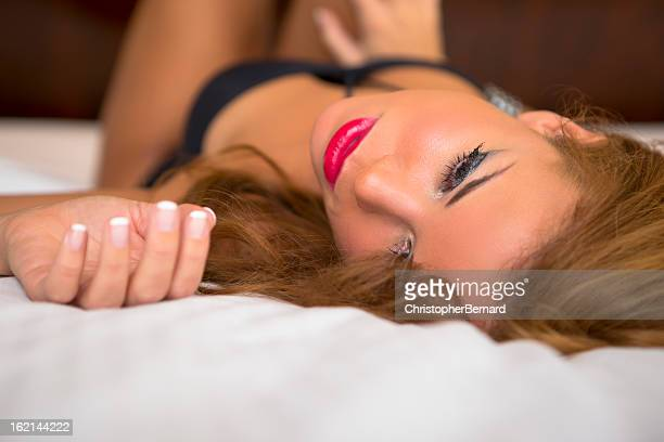 beautiful spanish woman in black lingerie - human leg stock photos and pictures