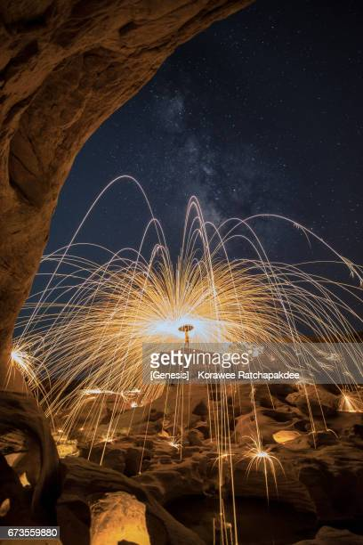 A beautiful spinning steel wool in the great canyon in Thailand along with the stars