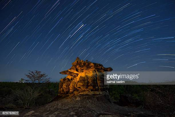 Beautiful Star Trails over the lonely rock. Beautiful night sky.