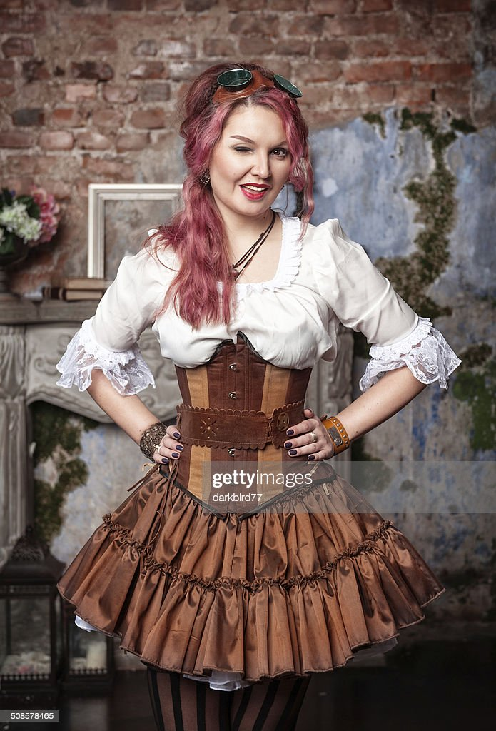 Beautiful steampunk woman winking : Stock Photo