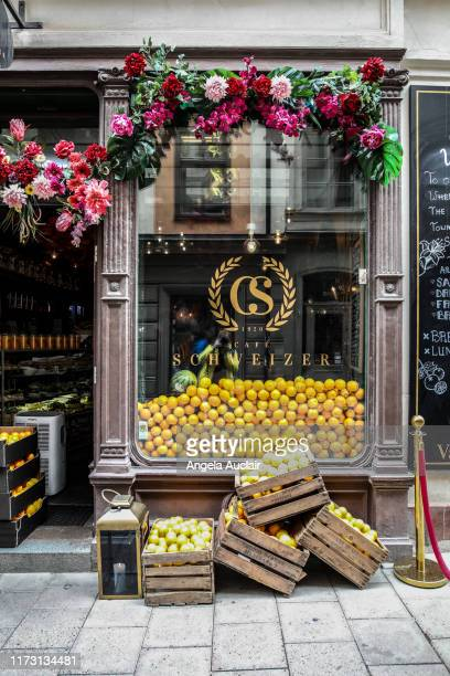 beautiful storefront with oranges in gamla stan, stockholm, sweden - angela auclair stock pictures, royalty-free photos & images