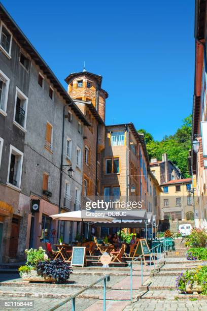 beautiful street of french trevoux town in auvergne-rhone-alpes region  with some tourists in sunny summer day - auvergne rhône alpes stock photos and pictures