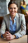 portrait happy young businesswoman smiling at