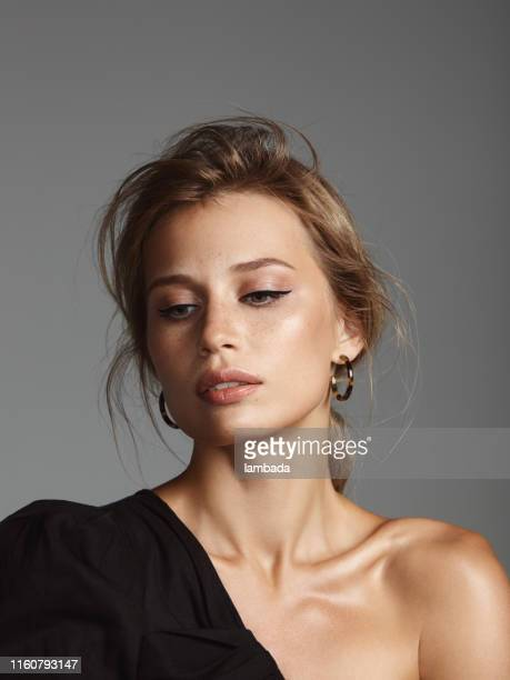 beautiful stylish woman wearing black top - eye liner stock pictures, royalty-free photos & images