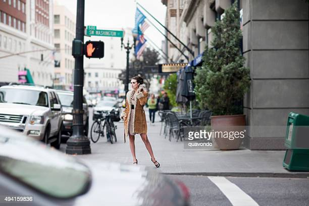 Beautiful Stylish Young Woman Fashion Model on Busy Downtown Street