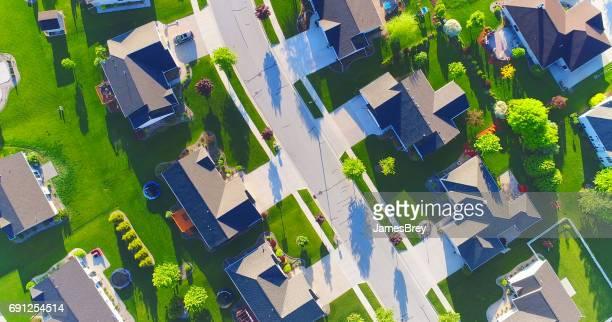Beautiful suburban homes, Springtime aerial view at sunrise.