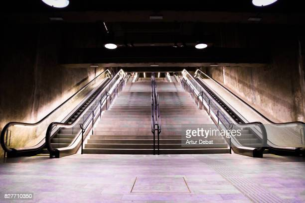 Beautiful subway facilities with escalators and stairs without people and futuristic architecture.