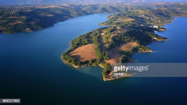 beautiful summer landscape of lake and mountains in the evening - peloponnese stock photos and pictures