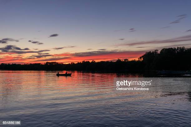 beautiful summer sunset with a colorful sky and clouds, reflection on the surface of the lake. - istock stock-fotos und bilder