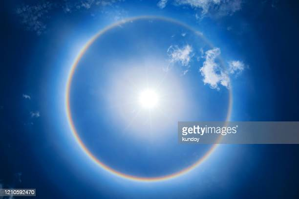 beautiful sun halo phenomenon in thailand. - halo symbol stock pictures, royalty-free photos & images