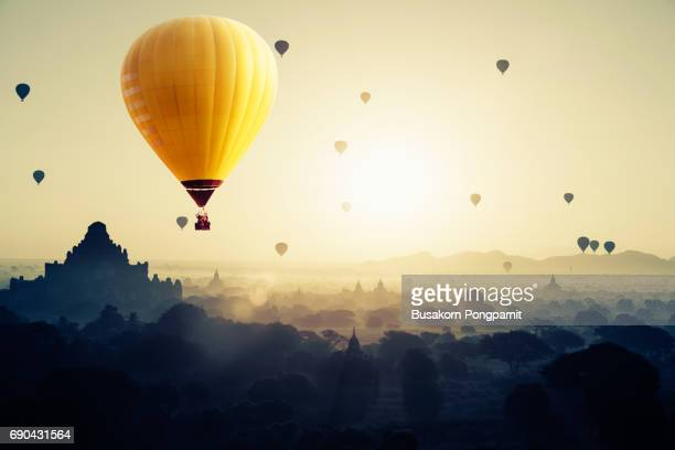 Beautiful sunrise and hot air balloons over ancient pagoda in Bagan is old kingdom in past, Myanmar