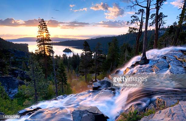 a beautiful sunrise at eagle falls at emerald bay in lake tahoe, california. - lake tahoe stock photos and pictures