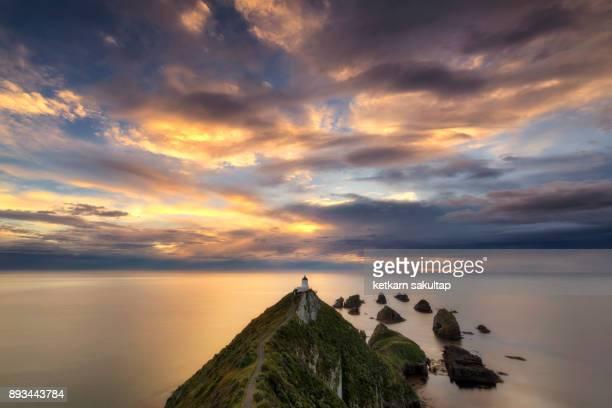Beautiful sunrise at Nugget point lighthouse, New Zealand.