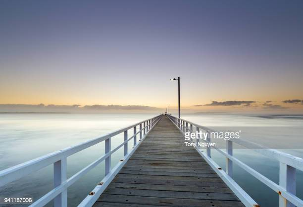 beautiful sunrise at point lonsdale, a coastal township on the bellarine peninsula, near queenscliff, victoria, australia with famous attractions including lighthouse and beautiful jetty. - victoria australia stock pictures, royalty-free photos & images