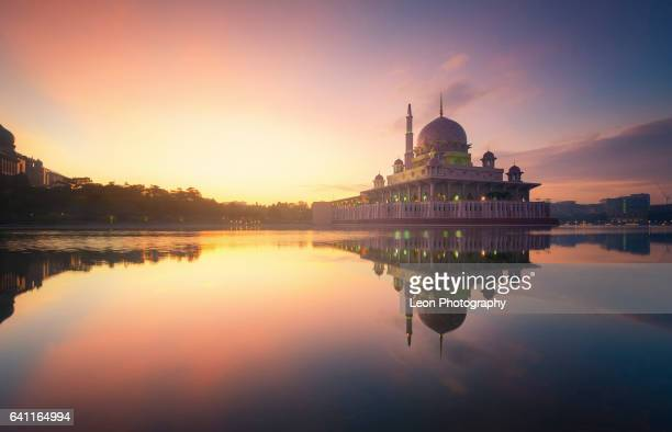 beautiful sunrise at putrajaya mosque - putrajaya stock photos and pictures