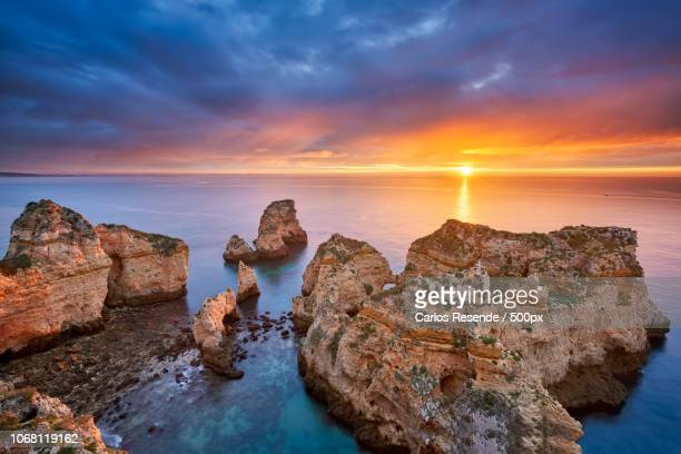 Beautiful sunrise at sea and rock formation in foreground