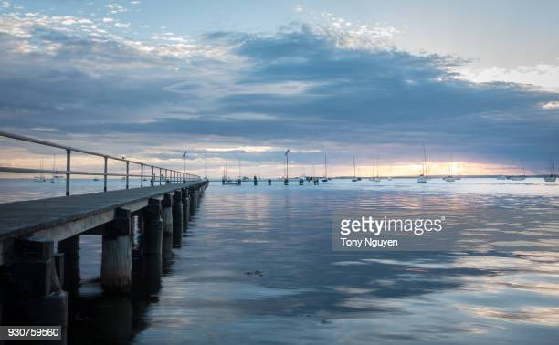 beautiful sunrise at waterfront of geelong, victoria, australia. a beautiful beach, good stop on the way to great ocean road. - ジーロング ストックフォトと画像