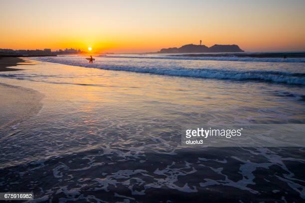 Beautiful sunrise on the beach with Enoshima