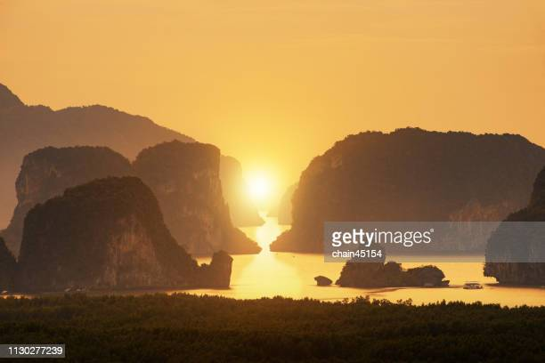 beautiful sunrise on the tropical island. traveling and destination background. - pacific islands stock pictures, royalty-free photos & images