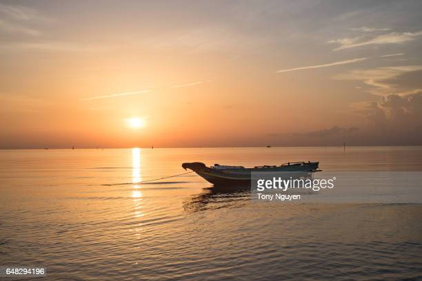 Beautiful Sunrise over a fishing boat. Fishery is one of the main industry in Asian Countries.