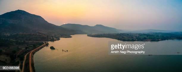 a beautiful sunrise over gundamagere lake - bangalore stock pictures, royalty-free photos & images