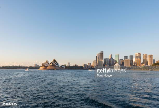 Sydney, Australia - April 15, 2017: Beautiful sunrise over Opera House and financial buildings viewed from Kirribilli in North Sydney.
