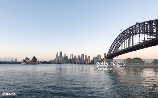 Beautiful sunrise over Opera House and Sydney Harbour Bridge viewed from Kirribilli in North Sydney.