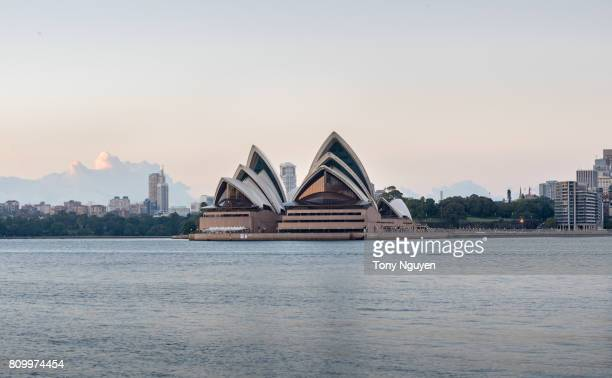 Sydney, Australia - April 15, 2017: Beautiful sunrise over Opera house in Sydney CBD with many financial towers around. Viewed from Wilson Point Wharf in Kirribilli, North Sydney.