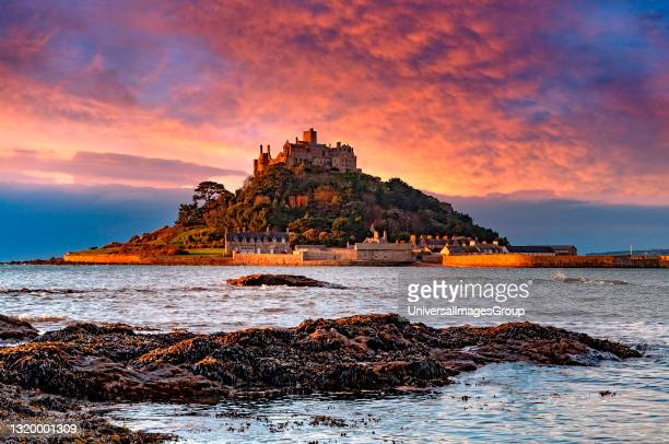 Beautiful sunrise over st michaels mount in cornwall england.